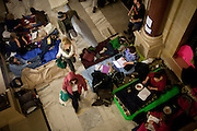 Protestors prepare to spend the night in the Wisconsin State Capitol over a bill that threatens to strip collective bargaining rights in Madison, Wisconsin, February 22, 2011.