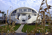 Apr 17, 2009 - Florida, <br /> <br /> Dome Of A Home<br /> <br /> could This be your future home if climate change increases extreme weather as predicted.  Valerie Sigler and her husband's Dome of a home that they built on Pensacola Beach, Florida after having their own home damaged by a hurricane, their construction paid off after this house survived several hurricanes lashing the house causing only minor damage to the front stair case. Domed or rounded houses fare much better in violent storms or hurricanes because wind and rain  runs off  the aerodynamic surfaces and makes them less likely to be damaged. Models forecast that tropical storms are likely to become stronger and more frequent, drought will bring more forest fires, and shrinking ice caps will raise sea levels worldwide meaning that  future proof  property will become increasingly important in our life time.<br /> ©Exclusivepix