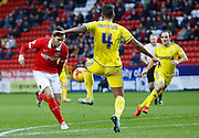Charlton Athletic defender Harry Lennon looks to strike a shot from just outside the box during the Sky Bet Championship match between Charlton Athletic and Nottingham Forest at The Valley, London, England on 2 January 2016. Photo by Andy Walter.
