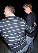 24.APRIL.2009 - LONDON<br /> <br /> A VERY CHEERFUL PRINCE HARRY LEAVING KITTS CLUB, KNIGHTSBRIDGE AT 4.00AM VIA THE BACK DOOR AND HE HAD A VERY DIRTY JUMPER WITH WHITE MARKS ALL OVER THE BACK OF HIS TOP AND WHEN THE ROYAL PROTECTION OFFICER PUT HARRY IN THE CAR YOU COULD CLEARLEY SEE THE OFFICER'S GUN STICKING OUT OF THE BACK AND BOTTOM OF HIS JUMPER.<br /> <br /> BYLINE MUST READ : EDBIMAGEARCHIVE.COM<br /> <br /> *THIS IMAGE IS STRICTLY FOR UK NEWSPAPERS & MAGAZINES ONLY*<br /> *FOR WORLDWIDE SALES OR WEB USE PLEASE CONTACT EDBIMAGEARCHIVE - 0208 954 5968*