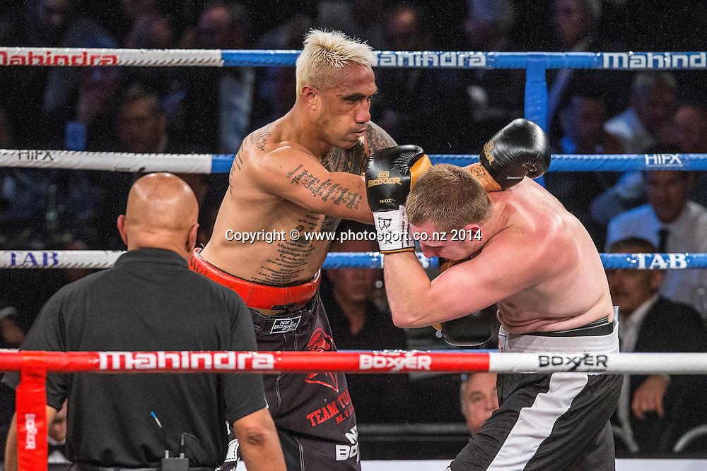 Monty Filimaea (L) fights James Emerson in the Mahindra Super 8 Fight Night, North Shore Events Centre, Auckland, New Zealand, Saturday, November 22, 2014. Photo: David Rowland/Photosport
