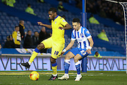 Leeds United midfielder, (on loan from Middlesbrough) Mustapha Carayol (18)  watched by Brighton defender, full back, Liam Rosenior (23)  during the Sky Bet Championship match between Brighton and Hove Albion and Leeds United at the American Express Community Stadium, Brighton and Hove, England on 29 February 2016. Photo by Simon Davies.