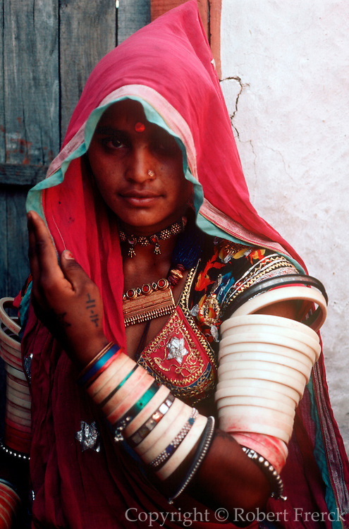 INDIA, PORTRAITS Portrait of a Rajasthani woman in traditional veil and jewelry from village nr Jodhpur