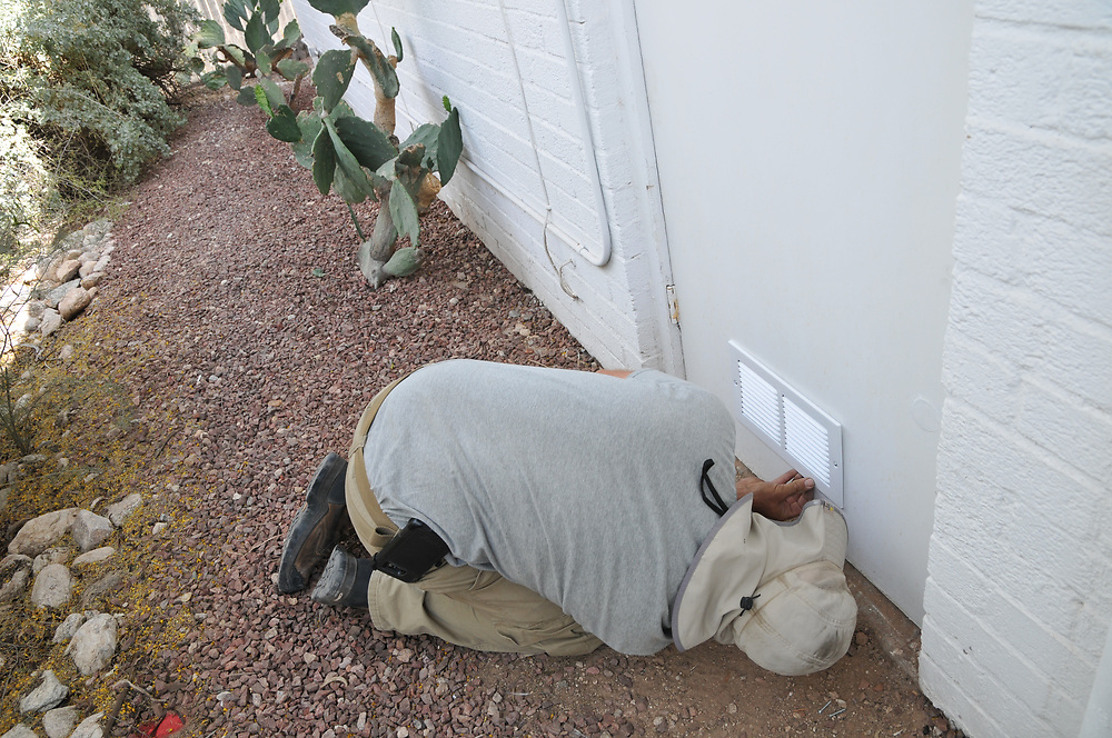 Jesse Micander installs louver on lower opening of my furnace room door.