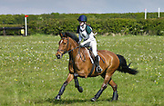 Young girl rides New Forest pony in cross country event in the Cotswolds, Gloucestershire, UK