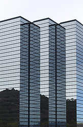 modern hi-rise corporate office building with glass exterior