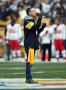 Chris Jamison, Voice Season 7 contestant and singer / songwriter, sings the National Anthem before the Pittsburgh Steelers NFL week 16 regular season football game against the Kansas City Chiefs on Sunday, Dec. 21, 2014 in Pittsburgh. The Steelers won the game 20-12 and clinched an AFC playoff spot. ©Paul Anthony Spinelli