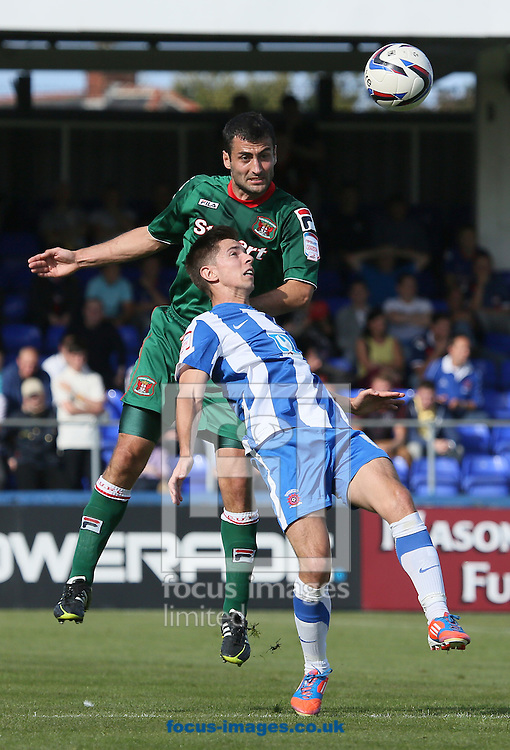 Picture by Paul  Gaythorpe/Focus Images Ltd +447771 871632.08/09/2012.James Poole of Hartlepool United and Mike Edwards of Carlisle United during the npower League 1 match at Victoria Park, Hartlepool.