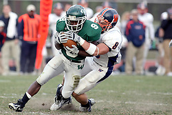 10 November 2007: Marcus Dunlop's run is stopped by Jonathan Toal. This game between the Wheaton College Thunder and the Illinois Wesleyan University Titans was for a share of the CCIW Championship and was played at Wilder Field on the campus of Illinois Wesleyan University in Bloomington Illinois.
