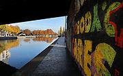 Graffiti beneath a bridge over the Canal de l'Ourcq in the 19th arrondissement of Paris, France. The Canal de l'Ourcq is a 108.1km waterway begun in 1802 between Port-aux-Perches and the Canal Saint-Martin via the Bassin de la Villette or La Villette Basin. Picture by Manuel Cohen