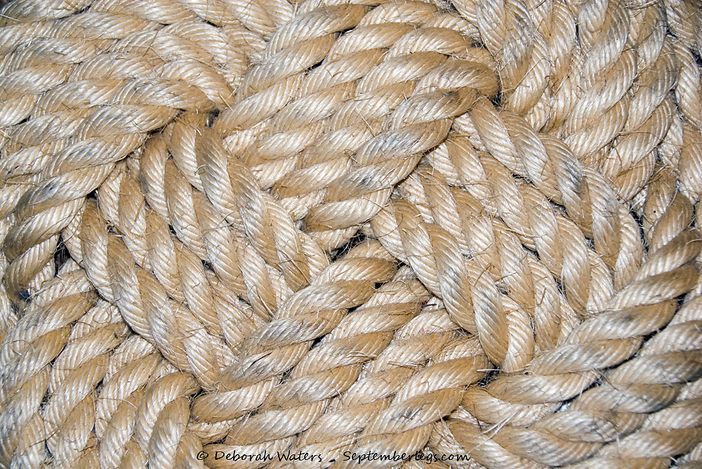 Close up on the twisted rope strands at the centre of a decorative knot called the Ocean Plait Mat, Postmouth Historic Dockyard, UK 2013
