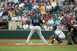 "1 June 2010: J.T. Restko watches a low pitch bounce past. The Windy City Thunderbolts are the opponents for the first home game in the history of the Normal Cornbelters in the new stadium coined the ""Corn Crib"" built on the campus of Heartland Community College in Normal Illinois."