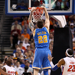 Mar 19, 2011; Tampa, FL, USA; UCLA Bruins forward Reeves Nelson (22) dunks over Florida Gators forward Alex Tyus (23) during first half of the third round of the 2011 NCAA men's basketball tournament at the St. Pete Times Forum.  Mandatory Credit: Derick E. Hingle