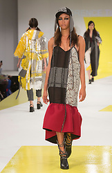 © Licensed to London News Pictures. 01/06/2015. London, UK. Collection by Florence Tudgay. Fashion show of De Montfort University (Leicester) at Graduate Fashion Week 2015. Graduate Fashion Week takes place from 30 May to 2 June 2015 at the Old Truman Brewery, Brick Lane. Photo credit : Bettina Strenske/LNP