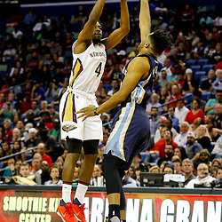 Mar 21, 2017; New Orleans, LA, USA; New Orleans Pelicans guard Jordan Crawford (4) shoots over Memphis Grizzlies guard Andrew Harrison (5) during the second half of a game at the Smoothie King Center. The Pelicans defeated the Grizzlies 95-82. Mandatory Credit: Derick E. Hingle-USA TODAY Sports