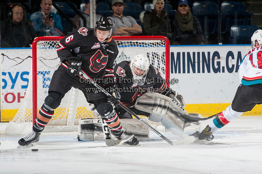 KELOWNA, CANADA - FEBRUARY 1: Jaydan Gordon #6 clears the puck from the front of Trevor Martin #1 of the Calgary Hitmen during first period against the Kelowna Rockets on February 1, 2017 at Prospera Place in Kelowna, British Columbia, Canada.  (Photo by Marissa Baecker/Shoot the Breeze)  *** Local Caption ***