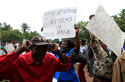 Zimbabwean people demonstrate against the xenophobic violence in South Africa outside the South African Embassy in Harare, Zimbabwe, April 17, 2015. EXPA Pictures © 2015, PhotoCredit: EXPA/ Photoshot/ Xu Lingui<br /> <br /> *****ATTENTION - for AUT, SLO, CRO, SRB, BIH, MAZ only*****
