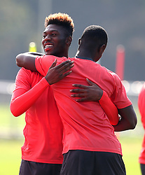 Timothy Fosu-Mensah of Manchester United hugs Eric Bailly during training - Mandatory by-line: Matt McNulty/JMP - 14/09/2016 - FOOTBALL - Manchester United - Training session ahead of Europa League Group A match against Feyenoord
