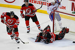 Jan 2, 2009; Newark, NJ, USA; New Jersey Devils center Brian Rolston (12) skates with the puck after a save by New Jersey Devils goalie Scott Clemmensen (35) during the third period at the Prudential Center.  The Devils defeated the Canadiens 4-1.