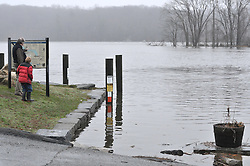Man pointing to place on Map as Boy looks on at the Deep River Landing during Connecticut River Flood. CT River High Water at Deep River Landing on 30 March 2010