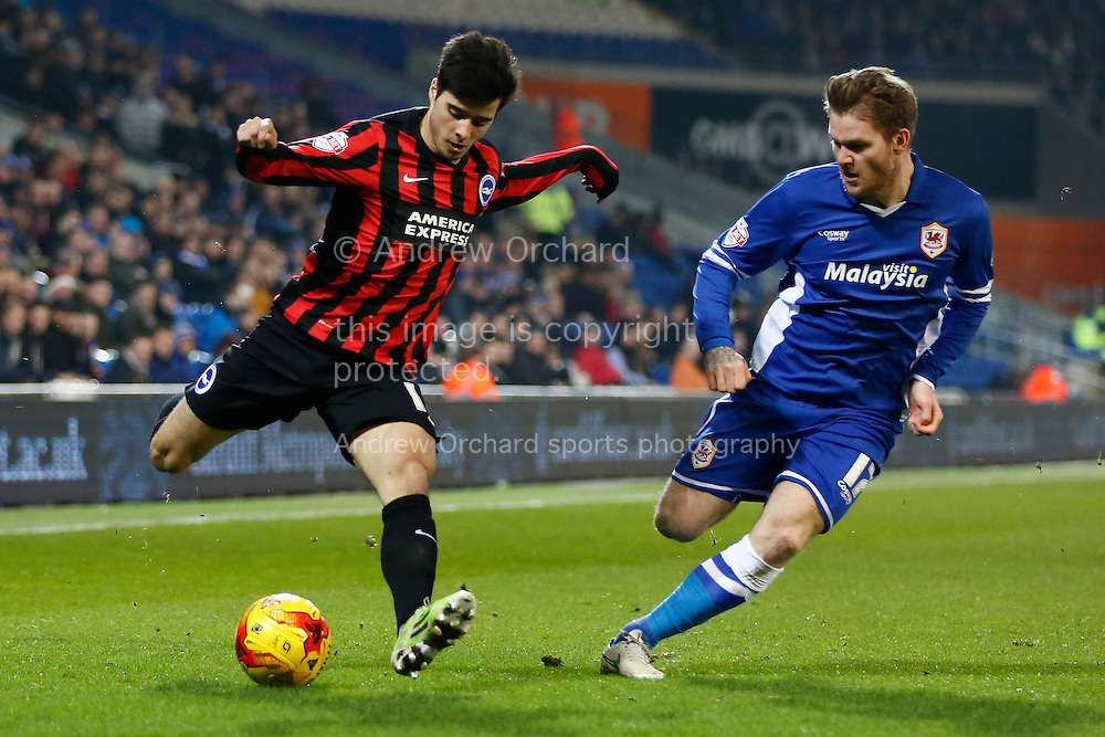 Joao Teixeira of Brighton takes on Aron Gunnarsson of Cardiff City. <br /> Skybet football league championship match, Cardiff City v Brighton &amp; Hove Albion at the Cardiff city Stadium in Cardiff, South Wales on Tuesday 10th Feb 2015.<br /> pic by Mark Hawkins, Andrew Orchard sports photography.