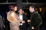 Janet Street-Porter and Peter Soros, Fundraising party with airline theme in aid of the Old Vic and to celebrate the appointment of Kevin Spacey as artistic director.  <br />Old Billinsgate Market.  5 February 2003. © Copyright Photograph by Dafydd Jones 66 Stockwell Park Rd. London SW9 0DA Tel 020 7733 0108 www.dafjones.com