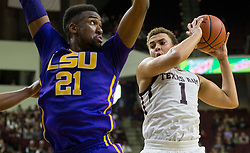 Texas A&M forward DJ Hogg (1) pulls down a rebound against LSU forward Aaron Epps (21) of an NCAA college basketball game Saturday, Jan. 6, 2018, in College Station, Texas. (AP Photo/Sam Craft)