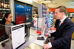 Pictured is Tom Pursglove MP, right, with postmistress Devyani Tailor using the Post Offices banking facilities<br /> <br /> Tom Pursglove MP has officially opened the new Post Office at the Weldon Supermarket in Weldon.<br /> <br /> Date: November 10, 2017