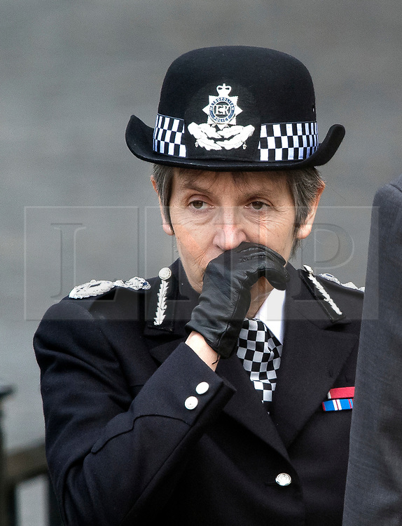 © Licensed to London News Pictures. 22/03/2018. London, UK. Met Police commissioner Cressida Dick joins Members of the Police Force as they hold a minutes silence at New Palace Yard, inside the grounds of the Houses of Parliament in Westminster, London at the time PC Palmer died, one year ago today in the Westminster Bridge Terror attack. A lone terrorist killed 5 people and injured several more, in an attack using a car and a knife. The attacker, 52-year-old Briton Khalid Masood, managed to gain entry to the grounds of the Houses of Parliament and killed police officer Keith Palmer. Photo credit: Ben Cawthra/LNP