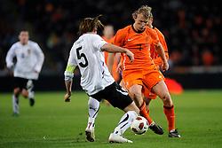 09-02-2011 VOETBAL: NEDERLAND - OOSTENRIJK: EINDHOVEN<br /> Netherlands in a friendly match with Austria won 3-1 / Dirk Kuyt NED and Christian Fuchs AUT<br /> ©2011-WWW.FOTOHOOGENDOORN.NL
