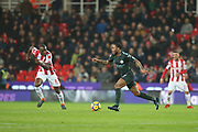 Bruno Martins Indi and Raheem Sterling during the Premier League match between Stoke City and Manchester City at the Bet365 Stadium, Stoke-on-Trent, England on 12 March 2018. Picture by Graham Holt.
