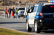 Construction crew members stand at the scene of an accident in Saratoga Springs where a 31-year old male died as the result of his injuries from a piece of heavy roadway machinery, Tuesday, Nov. 27, 2012.