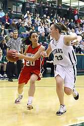 29 January 2011: Taylor Tondelli heads for the hoop guarded by Olivia Lett  during an NCAA Womens basketball game between the Carthage Reds and the Illinois Wesleyan Titans at Shirk Center in Bloomington Illinois.