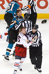 Jan 31, 2012; San Jose, CA, USA; NHL linesman Scott Driscoll (68) and linesman Pierre Champoux (67) separate Columbus Blue Jackets right wing Derek Dorsett (bottom, left) and San Jose Sharks defenseman Colin White (middle, left) after a fight during the third period at HP Pavilion. San Jose defeated Columbus 6-0. Mandatory Credit: Jason O. Watson-US PRESSWIRE