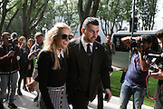 Olivia Palermo, an American socialite, leaves with a bodyguard the Armani theatre where took place Armani fashion show during annual Milan Fashion Week, Milan 23 Sept. 2016. © Carlo Cerchioli