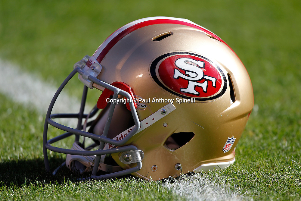 A San Francisco 49ers helmet sits on the grass before the NFL week 11 football game against the Tampa Bay Buccaneers on Sunday, November 21, 2010 in San Francisco, California. The Bucs won the game 21-0. (©Paul Anthony Spinelli)