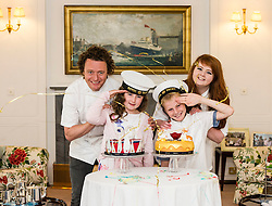 "Pictured: Tom Kitchin, Lucy Kearney (8), Alfie Bennet (11) and Vicki Tighe<br /> <br /> Chefs Tom Kitchin and Vicki Tighe  presented primary pupils Alfie Bennet and Lucy Kearney with nine-inch versions of their winning entries for the ""Design a Cake for The Queen's 90th Birthday"" competition o the Royal Yacht Britannia today. <br /> Ger Harley 