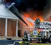 The Mount Pilgrim Baptist Church on 39th Street East in Tuscaloosa was destroyed by fire Thursday morning, March 21, 2019. The church steeple crashes to the ground after fire consumed its base. [Staff Photo/Gary Cosby Jr.]