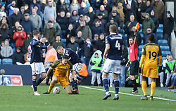 Shane Ferguson of Millwall appears to stamp on Lewis Dunk of Brighton and Hove Albion - Mandatory by-line: Arron Gent/JMP - 17/03/2019 - FOOTBALL - The Den - London, England - Millwall v Brighton and Hove Albion - Emirates FA Cup Quarter Final