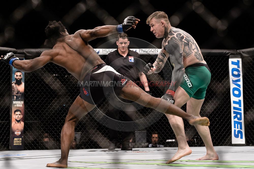 "GLASGOW, UNITED KINGDOM, JULY 16, 2017: Galore Bofando (black trunks) versus Charlie Ward during ""UFC Fight Night Glasgow: Nelson vs. Ponzinibbio"" inside the SSE Hydro Arena in Glasgow, Scotland on Sunday, July 16, 2017."
