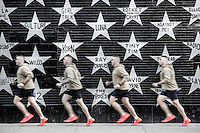 Composite image of a jogger running past the wall of First Avenue & 7th St Entry, Minneapolis, Minnesota, USA.