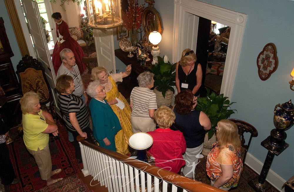 Jane Niles (center, in yellow) conducts a tour of Rosewood Manor in Columbus, Miss. April 16, 2010. The 1835 Greek-Revival antebellum mansion was among nearly two dozen on tour during Columbus' annual Spring Pilgrimage. (Photo by Carmen K. Sisson/Cloudybright)
