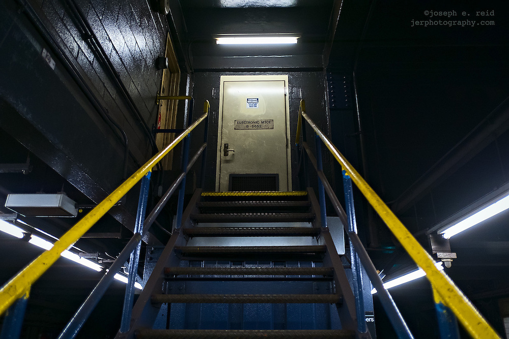 """Stairs from subway platform to door marked """"Electronic mice"""""""