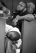 Kevin Hutchins, with his son Quadir clinging to his leg, listens to the sentencing of Taron Johnson, the teenager who shot Quadir.  Johnson was aiming for the driver of the car but he hit Quadir instead.  Johnson pleaded guilty and was sentenced to 15 years in prison.