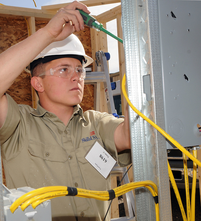 jt033117b/a sec/jim thompson/  Jessie Trevino of Hobbs High School runs wires into an electrical panel in the  SkillsUSA  competition on the CNM Main campus in Albuquerque, NM. Friday March 31, 2017. (Jim Thompson/Albuquerque Journal)