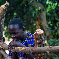 Young Ugandan girl watches activity between Ugandans and soap making team
