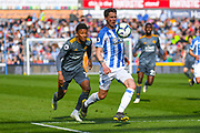 Eric Durm of Huddersfield Town (37) chased down by Demarai Gray of Leicester City (7) during the Premier League match between Huddersfield Town and Leicester City at the John Smiths Stadium, Huddersfield, England on 6 April 2019.