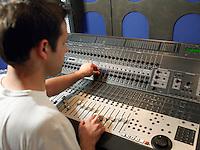 Sound technician in recording studio back view