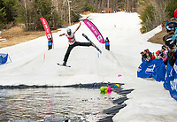 Jackson Hillsgrove hits the jump and flys over the pond during Gunstock's annual end of the season B.Y.O.D.C. event on Sunday afternoon. (Karen Bobotas/for the Laconia Daily Sun)