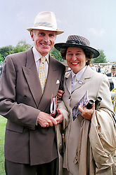 The HON.SIR DAVID & LADY SIEFF at a race meeting in Sussex on 4th August 2000.OGO 55